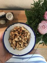 Do you know how to make the salt stick to roasted cashews?   You roast them on a medium heat for a while (maybe ten minutes) until nice and toasty then add a dash of the best water you can find and a good sprinkle of salt, mix, let evaporate and cool. There you go!