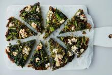 spring green frittata with wild garlic, chopped up into slices on white board,  by Anna Jones from the guardian